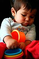 Baby playing with colorful cups