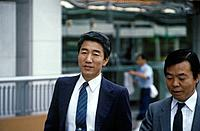 Japanese business men wearing suits. In street.
