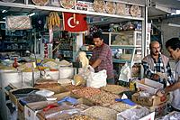 Small provincial town market. Nut stall. Goods displayed. Men.