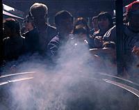 Senso_Ji. Incense cauldron. People purifying themselves with smoke.