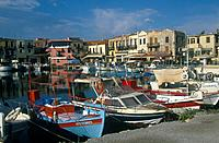 Venetian harbour,quayside buildings. Tavernas,boats moored.