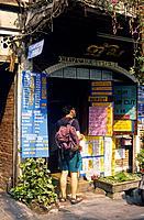 Banglamphu. Khao San Road. Travel agency. Signs. Young man with backpack,rucksack.