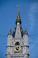 Belfry,Belfort tower.Tower. Clock. Spire. Golden dragon.
