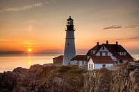 The first rays of sun after sunrise reach the Portland Head Light, built in 1791, which protects mariners entering Casco Bay. The lighthouse is locate...