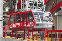 The newly renovated Roosevelt Island Tram approaches the Roosevelt Island station, New York City, New York, USA