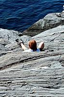 Man, Fallen on Rock Cliff at Oceanside