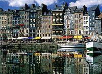 Tall terraced houses lining the habour,shops,cafes and resturants at street level.