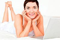 Close up of a woman posing with a laptop against a white background