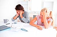 Concerned couple with accountings in their living room