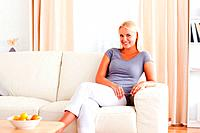 Woman sitting on a couch while looking at the camera