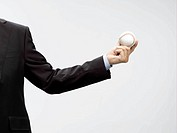 businessman holding baseball