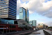 Moevenpick hotel and Passenger Terminal Amsterdam at a canal, Amsterdam, the Netherlands, Europe