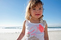 Happy baby girl at the beach