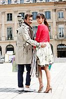 Couple walking on a street, Paris, Ile_de_France, France