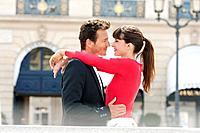 Romantic couple on a street, Paris, Ile_de_France, France