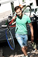 Man carrying a sports bicycle on his shoulders, Paris, Ile_de_France, France
