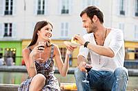 Couple drinking red wine, Paris, Ile_de_France, France