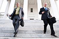 Businessmen walking down steps