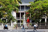People and statue in front of Government House, Port Louis, Mauritius, Africa