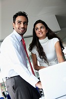 Smiling business people working together in office