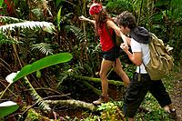 Hispanic couple hiking together in forest