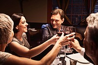 Couples toasting with red wine in restaurant