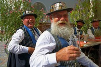 Swiss Group in traditional dress in open air restaurant in the town of Wolfach, Valley Kinzigtal, Southern Part of Black Forest, Black Forest, Baden_W...
