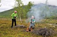 man making a campfire, Nordmannvikdalen valley, region of Lyngen, County of Troms, Norway, Northern Europe