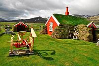 Red house with the turf covered roof, Borgarfjordur, north Iceland