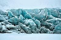 Blue glacier in cold snowy winter day, Greenland