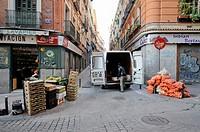 Man delivering fruit in Lavapies, Madrid