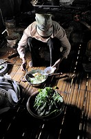 Vietnam, province of Hoa Binh, national Park of Cuc Phuong, Ban Ko Muong, White Thai ethnic group woman cooking