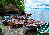 Boats moored on the shores of Lough Owel, near Mullingar, County Westmeath, Ireland.
