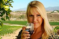 Attractive Woman Sips Wine