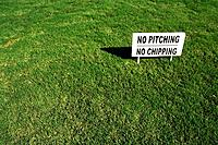No Pitching or Chipping Sign on Lush Green Grass