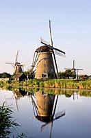 Wind mills next to canal, Holland