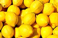 Lemon yellow citrus fruits in the marketplace