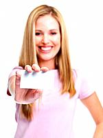 Portrait of a joyful young woman showing blank business card isolated over white background