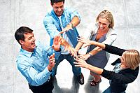 Top view of business team enjoying success with their hands raised
