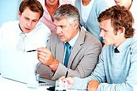 Senior business man guiding his colleagues in a meeting at office