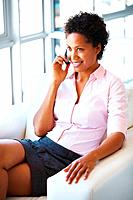 Young business woman talking on cell phone