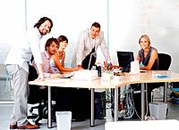 Portrait of successful business team working in board room