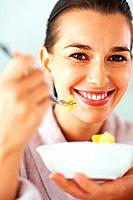 Smiling woman with bowl of fruit