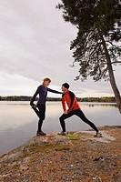 Couple exercising on lakeshore