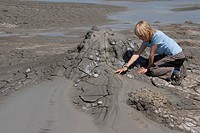 child watching vulcanic mud bubbling, Italy, Sicilia, Aetna