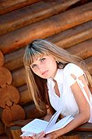 Girl with book at wooden wall