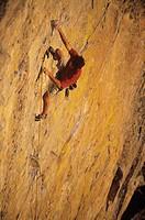 Male rock climber on steep cliff, Great White Wall, Skaha Bluffs, Okanagan, British Columbia, Canada.