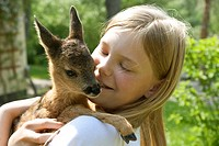 roe deer Capreolus capreolus, female with a fawn on her arms, Germany