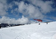 Evacuation of an injured person by helicopter in the Alps.