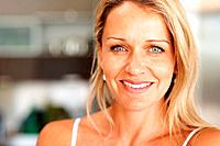 Closeup portrait of a beautiful happy mid adult woman smiling